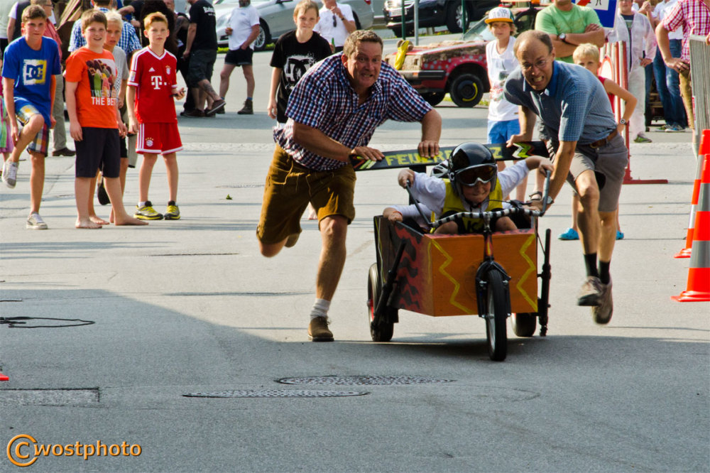 Pushing the soap box racer at the start in Werfen, Salzburg/Austria