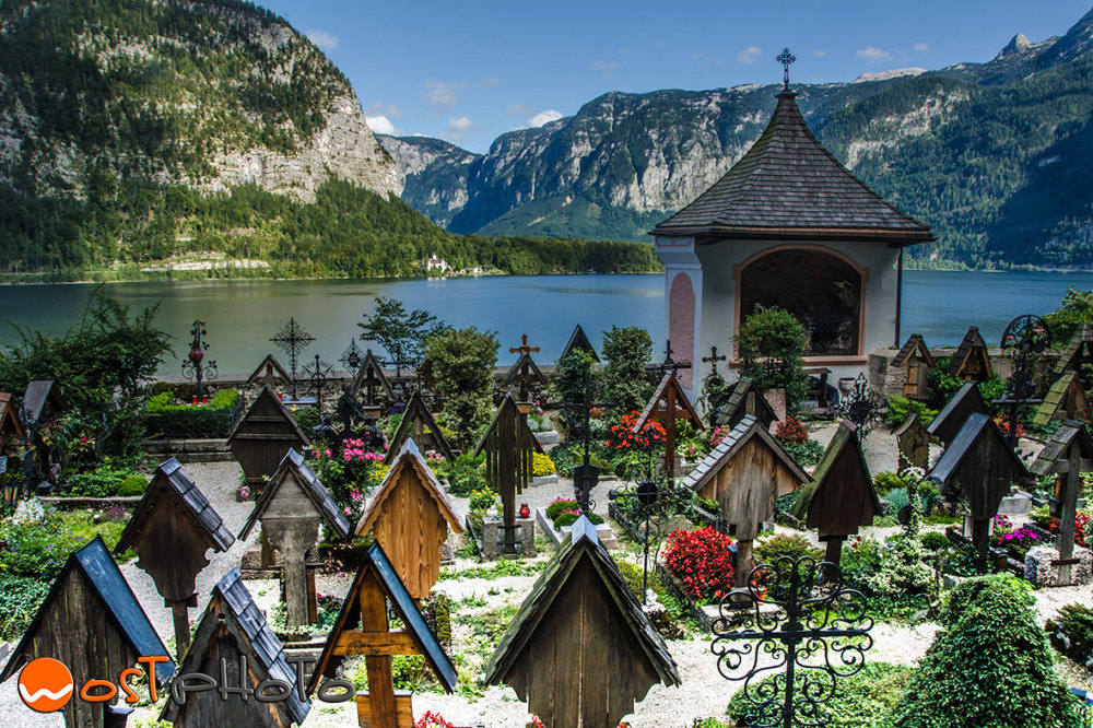 Graves at the little cemetery in Hallstatt, Upper Austria, with view onto the lake Hallstaettersee