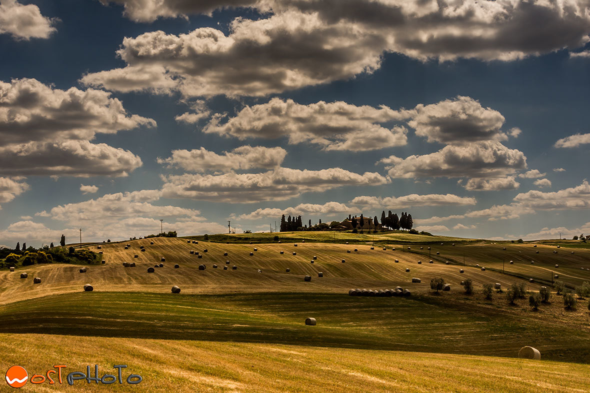 Val d'Orcia farm land with hay bales