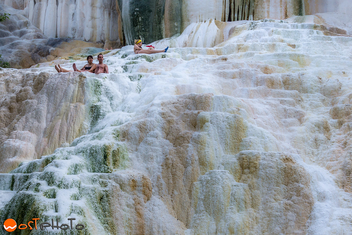 People sitting in pools of the hot springs in Tuscany's Bagni San Filippo in Val d'Orcia