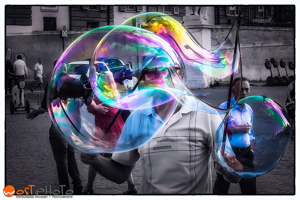 Huge colorful soap bubble framed with mat
