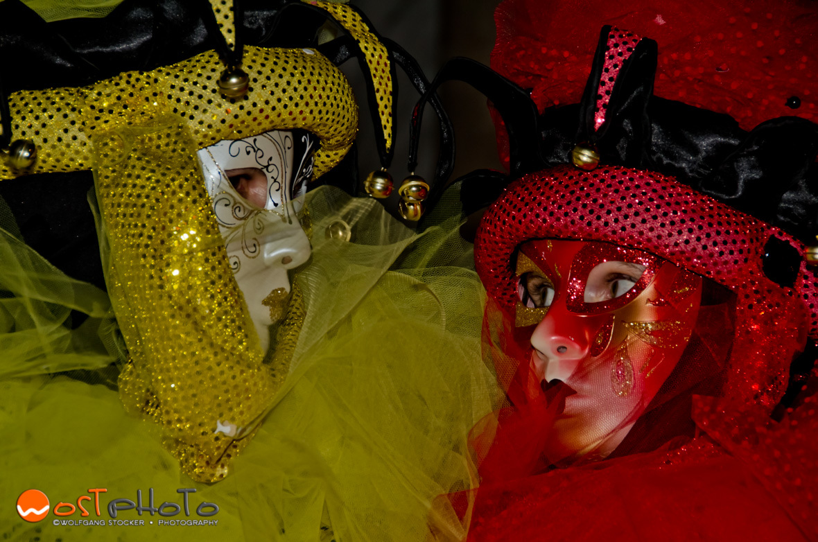 Venetian masks posing during the Carnival in Venice in 2012