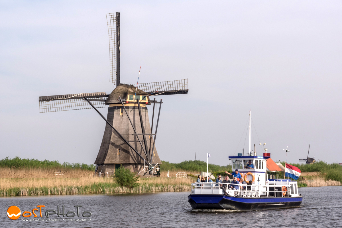 Cruise ship passing the windmills in Kinderdijk in the Netherlands